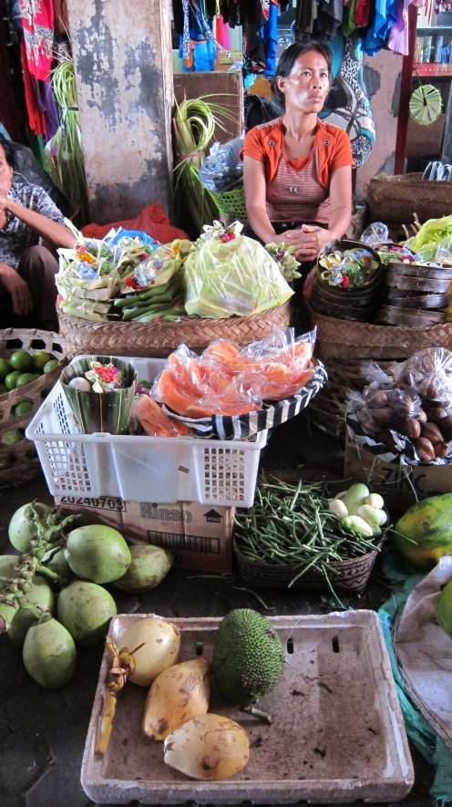 I wanted to take a stab at Balinese cooking so I took a half-day class. We started at the market to pick out fresh fruits and vegetables. I sampled a few fruits I'd never tried including snake skin fruit.